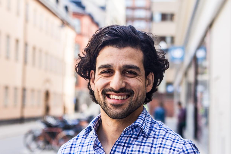 man smiles at camera